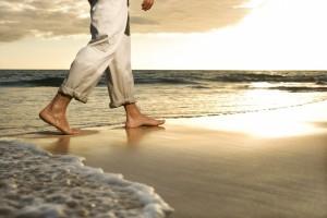 Legs walking on beach