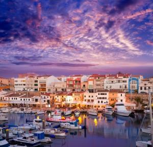 Ciutadella Menorca marina Port sunset with boats and streetlights in Balearic islands