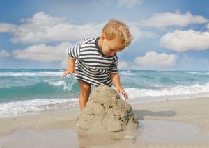 baby boy playing on beach